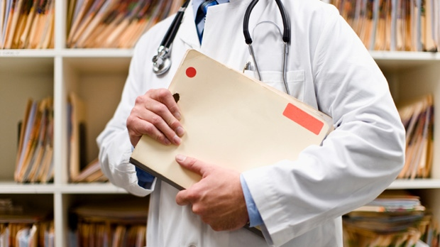 doctor with patient file